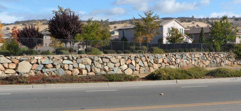 rock wall around residential neighborhood