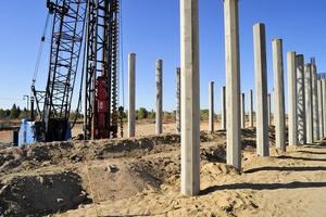 concrete piles being set in riverbed